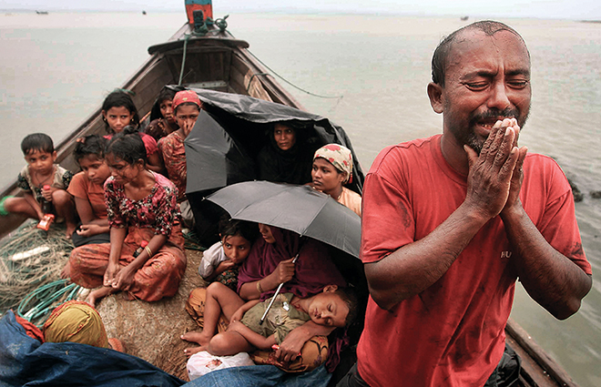 Rohingya Muslim bettelt um Einlass in Bangladesh